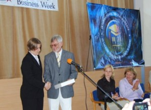 "Chairman Stanisław Szwabski accepts Mayor Nickel's ""Gdynia Week"" proclamation, presented by SGSCA"